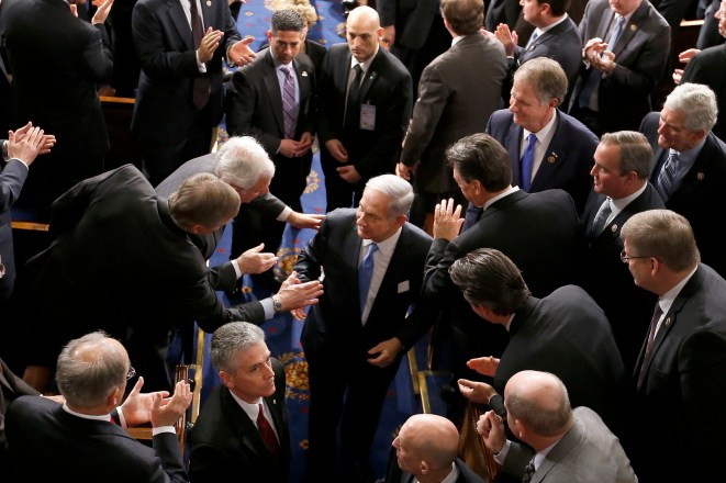 Members of Congress rush to greet Israeli Prime Minister Benjamin Netanyahu as he leaves the House chamber on Capitol Hill in Washington, Tuesday, March 3, 2015, after lobbying Congress to kill a peace plan with Iran at all costs. Studies show that more than half of Congress will themselves go on to become lobbyists. (AP Photo/Andrew Harnik)