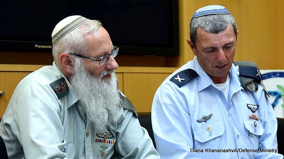 Rabbi Col. Eyal Karim (left), nominated to become IDF chief rabbi, sits next to his predecessor, Brig. Gen. Rafi Peretz, on April 21, 2016