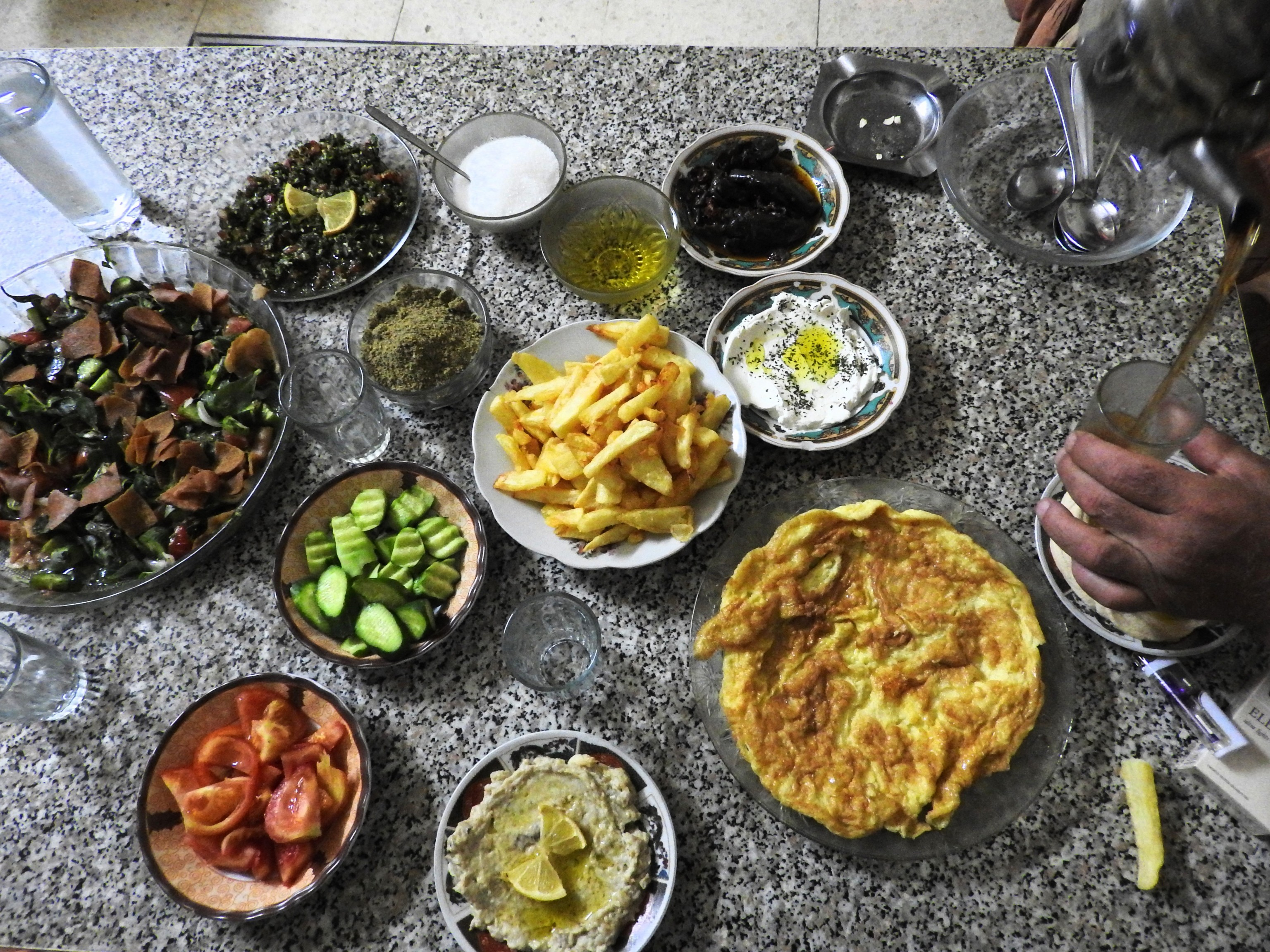 A shared meal with local family in the Old City. After over five years of the war on Syria, prices for all basic goods have risen dramatically, while incomes remain the same or shattered. The Western sanctions on the Syria worsen the situation, hurting the Syrian people and social services the most.