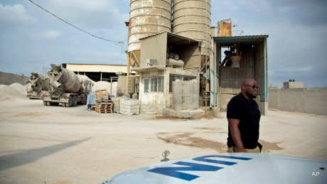 Keith Mathias-O'Chez, an inspector of building materials for the U.N. Relief and Works Agency, visits one of seven mixing concrete factories that are responsible for preparing the concrete for the U.N. projects in the Gaza Strip.