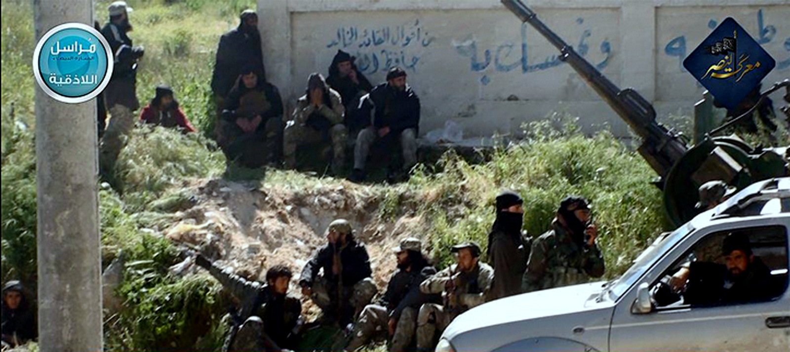 Fighters from Nusra Front,. Al-Qaida's branch in Syria, in the town of Jisr al-Shughour, Idlib province.