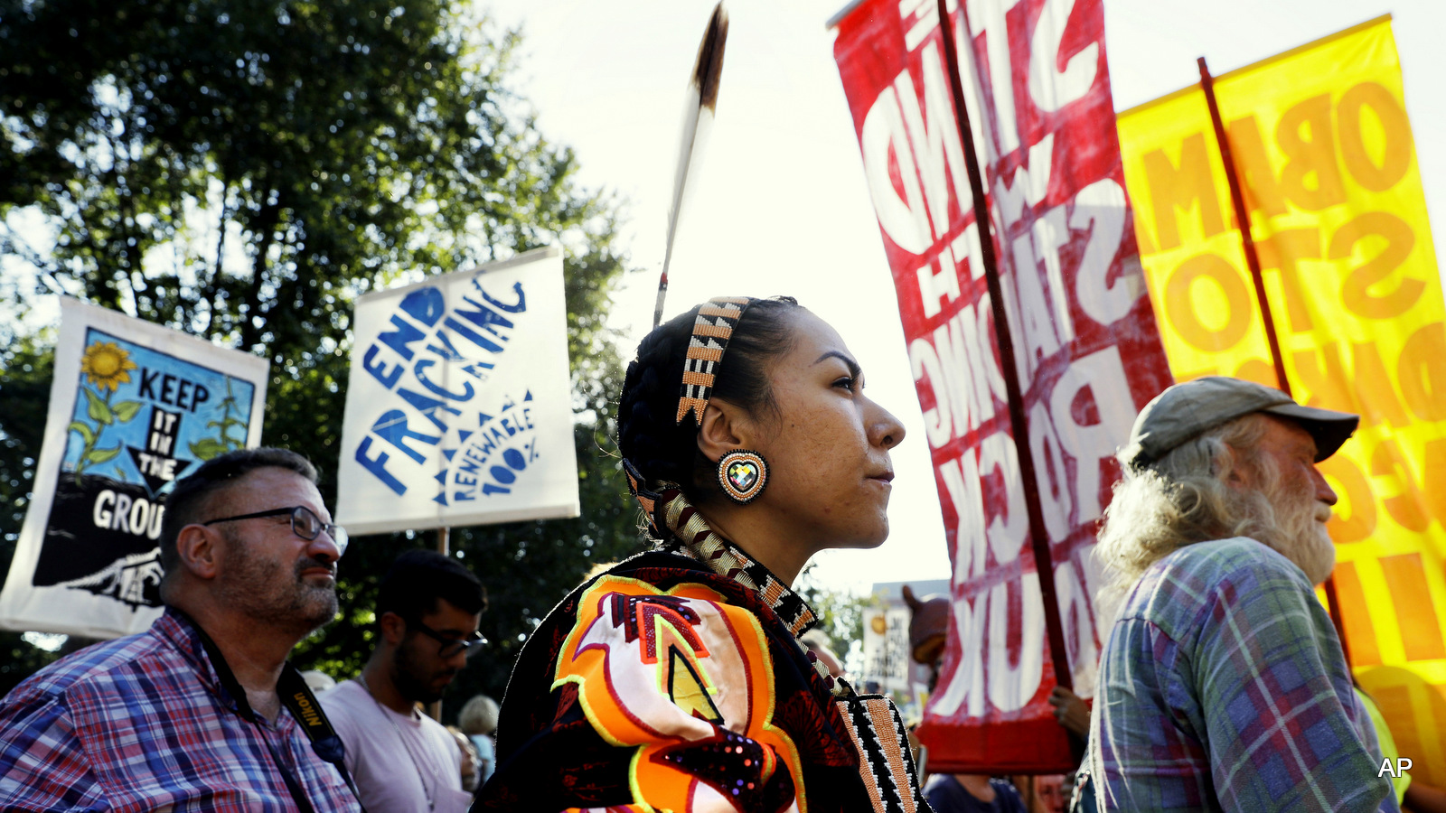 Angela Miracle Gladue, center, a member of the Frog Lake First Nations, a Cree community in Edmonton, Alberta, Canada, attends a rally in support of the Standing Rock Sioux Tribe and in opposition of the Dakota Access oil pipeline, in Lafayette Park near the White House, Tuesday, Sept. 13, 2016, in Washington.