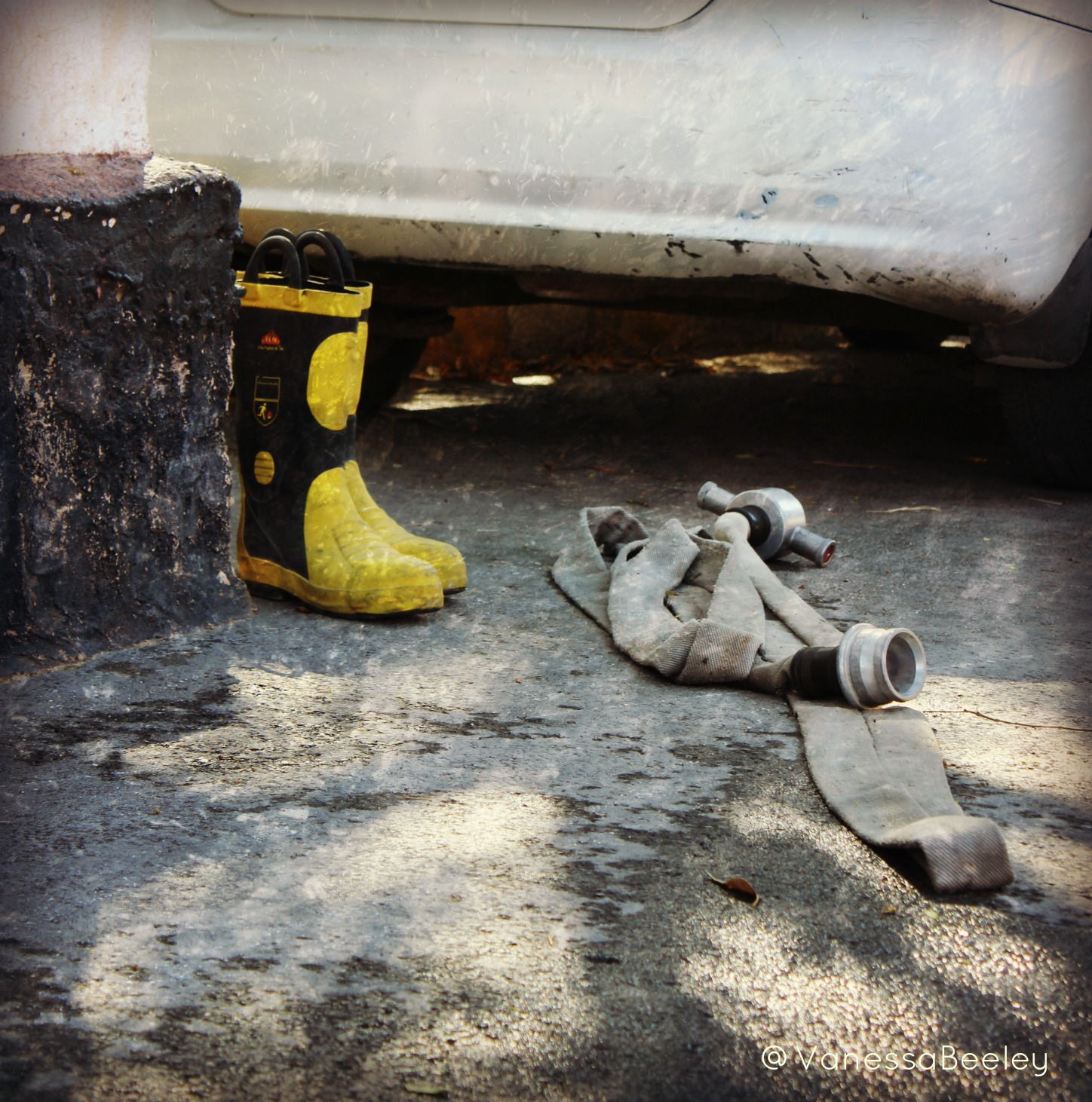 Boots and a fire hose sit in the corner of the yard of the real Syria Civil Defense, waiting for the next call. (Photo: Vanessa Beeley)