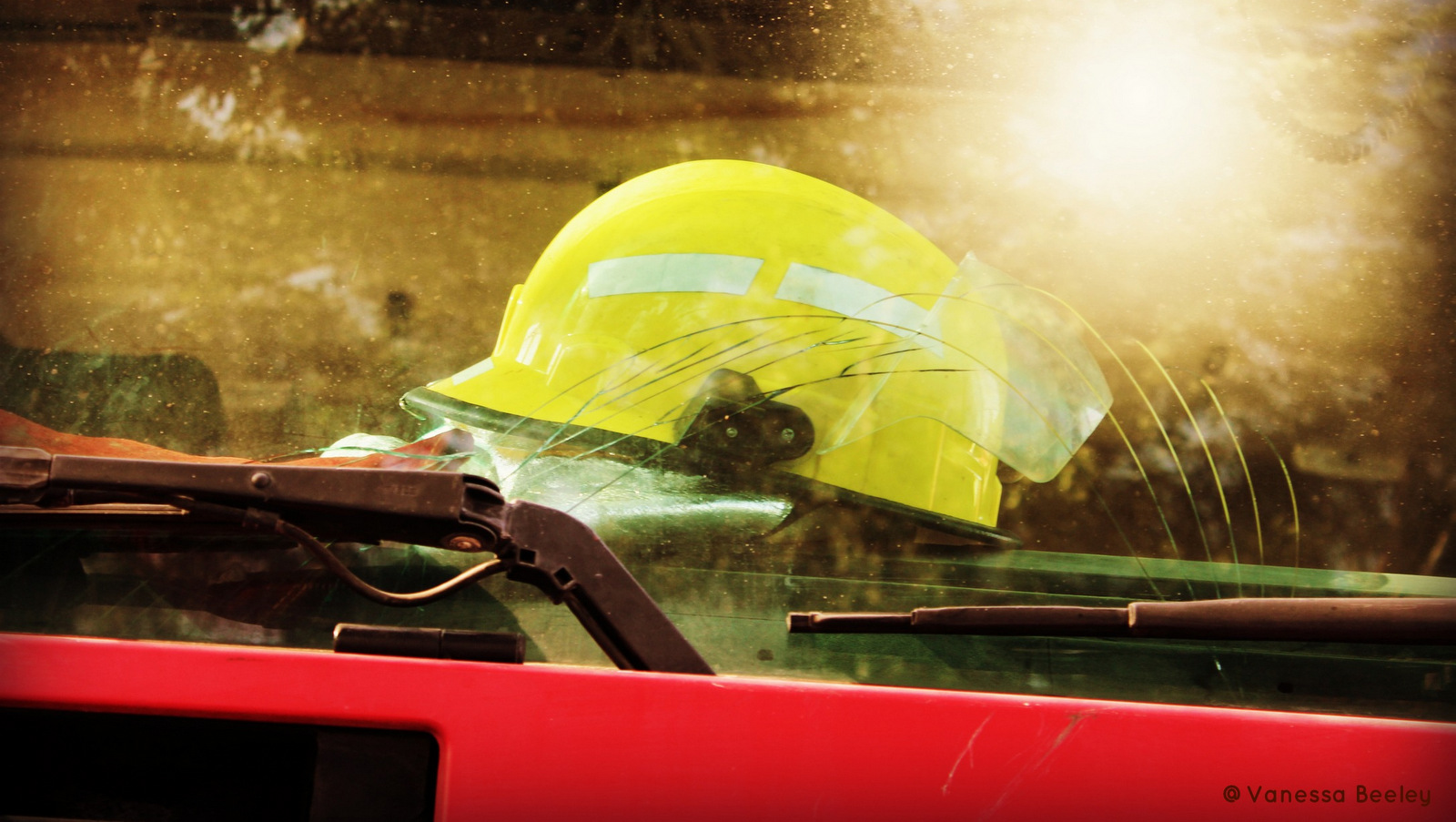 A helmet used by the real Syria Civil Defense is perched on the dashboard, ready for action.  (Photo by Vanessa Beeley)