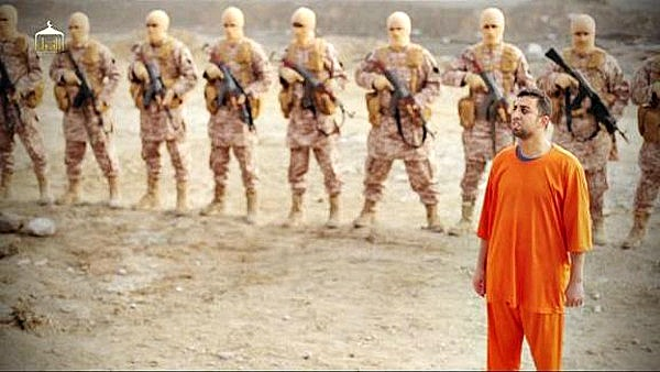A screenshot from a video released by ISIS, shows the execution of Jordanian pilot Moaz-al-Kasasbeh in 2015. Vvery well-equipped ISIS militants are visible behind al-Kasasbeh.