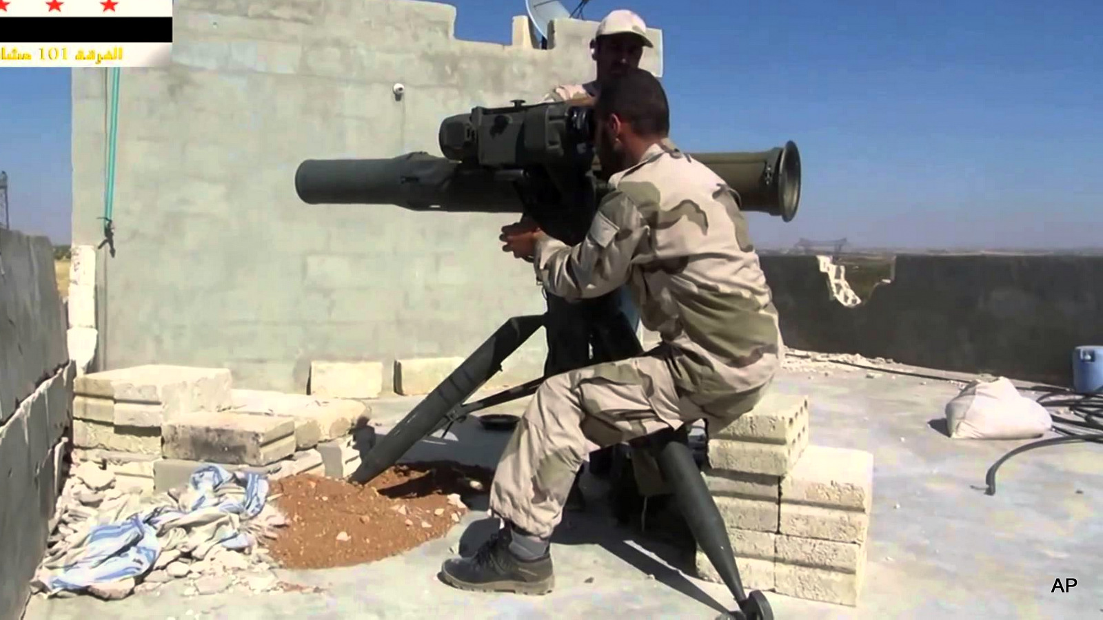 A well-equipped Syrian rebel using a US-made BGM-71 TOW on the Syrian Arab Army. (Photo YouTube Screenshot)