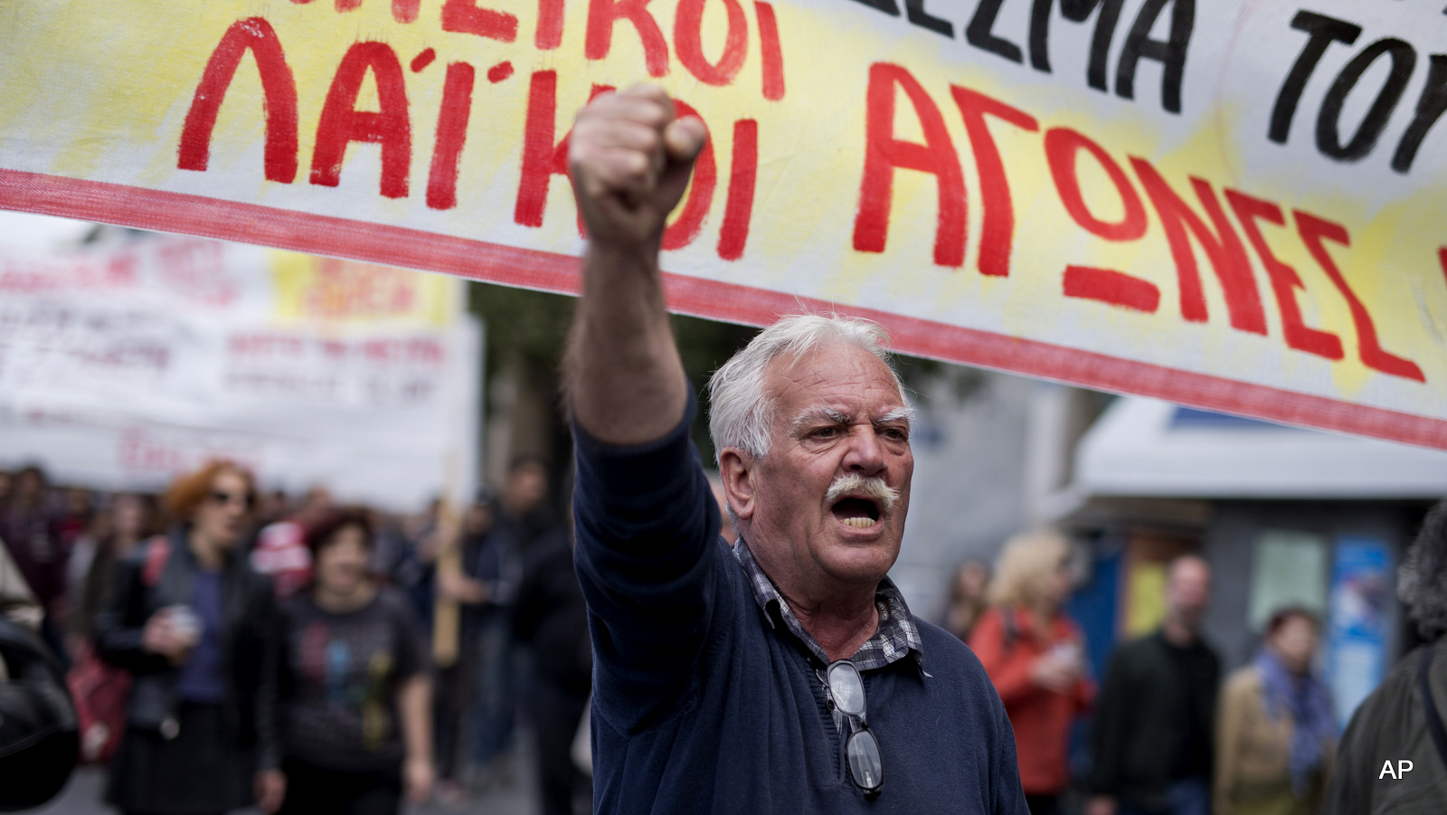 A protester chants anti austerity slogans during a demonstration in central Athens, on Friday, May 6, 2016. A protester chants anti austerity slogans during a demonstration in central Athens, on Friday, May 6, 2016.