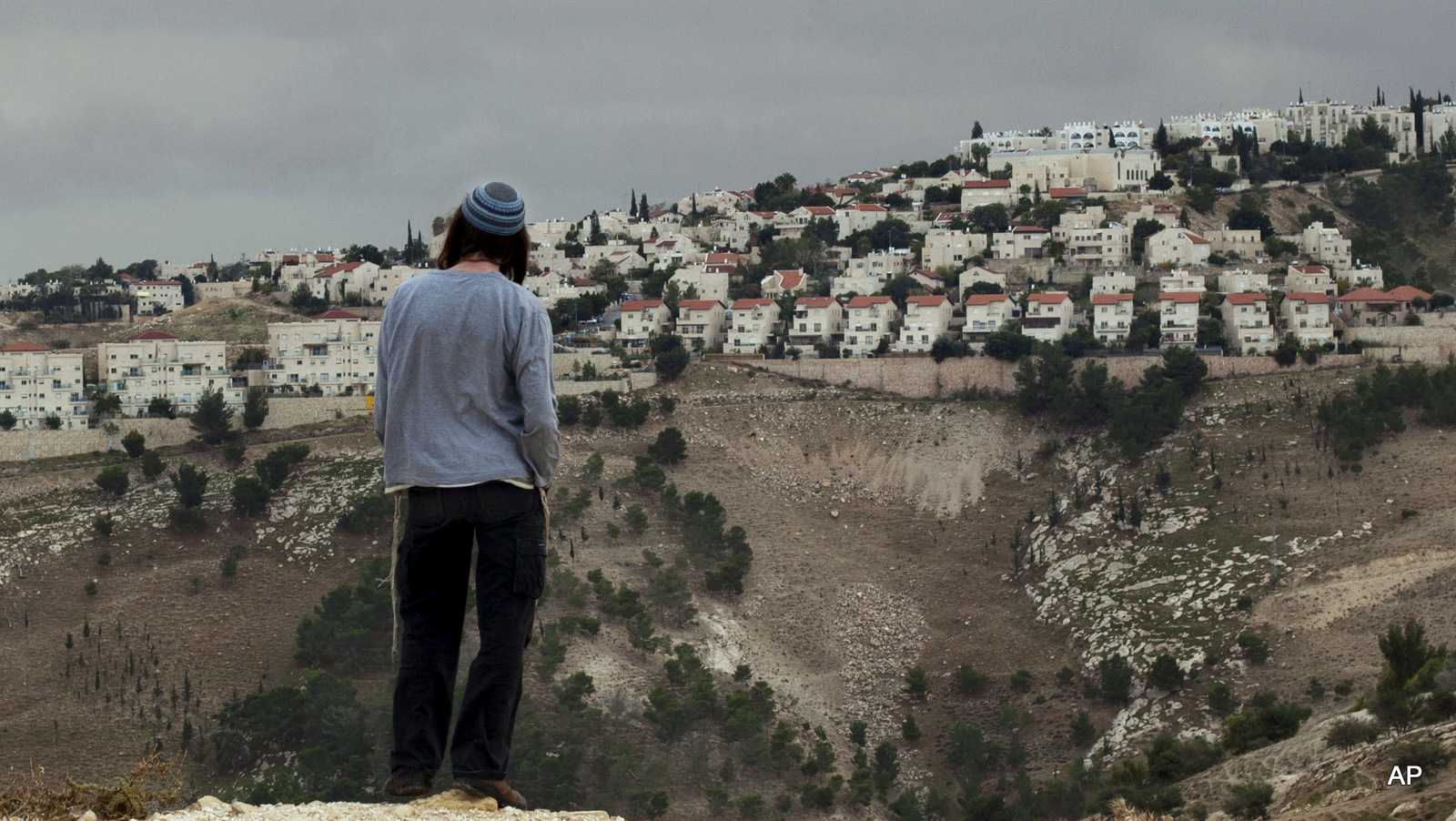 A Jewish settler looks at the West bank settlement of Maaleh Adumim, from the E-1 area on the eastern outskirts of Jerusalem.