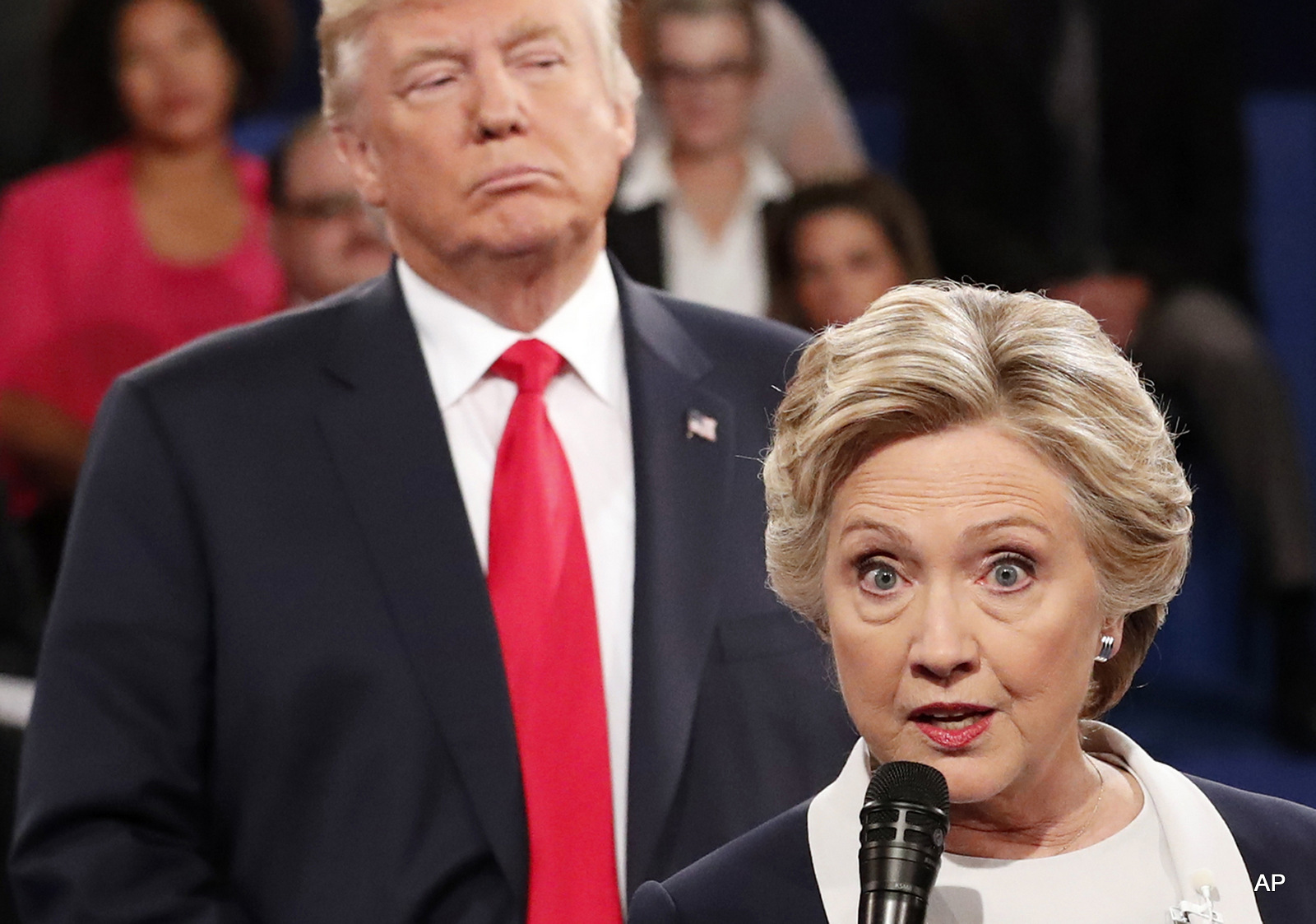 Democratic presidential nominee Hillary Clinton, right, speaks as Republican presidential nominee Donald Trump listens during the second presidential debate at Washington University in St. Louis, Sunday, Oct. 9, 2016.