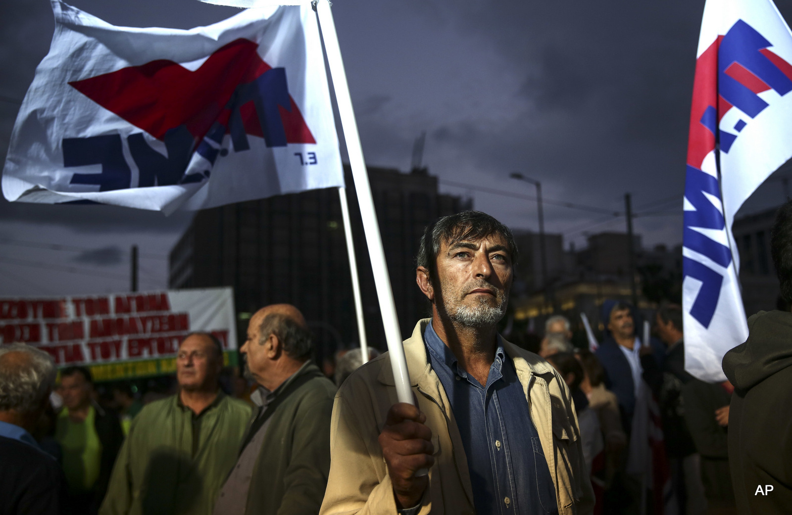 A supporter of the communist-affiliated union PAME takes part in an anti-austerity rally in front of the parliament in Athens, Monday, Oct. 17, 2016.