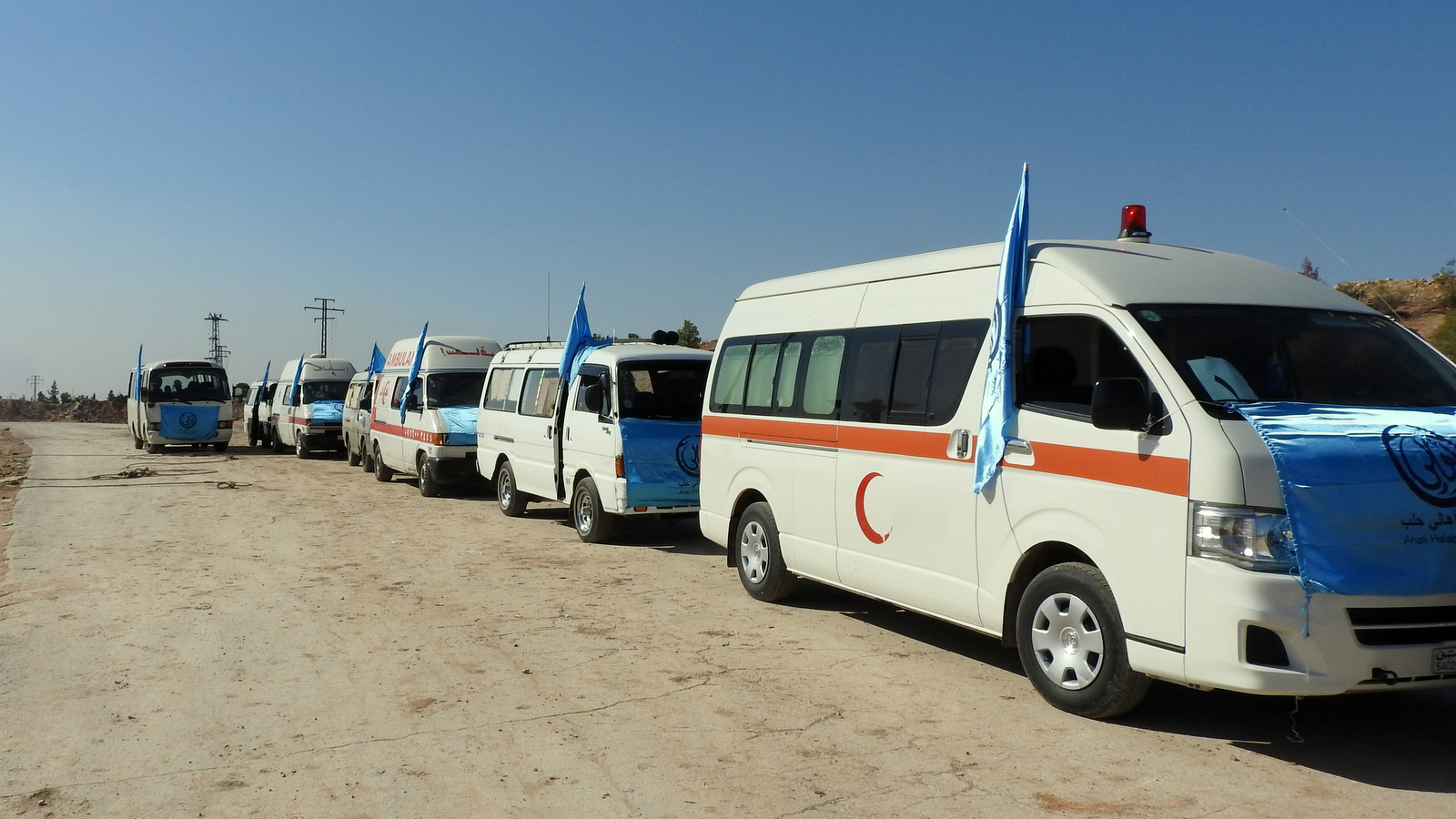Ten ambulances wait at the Castello Road crossing to treat anyone exiting via the humanitarian corridors established by the Syrian government and Russia, including militants who lay down their arms. Nov. 4, 2016. (Photo: Eva Bartlett)
