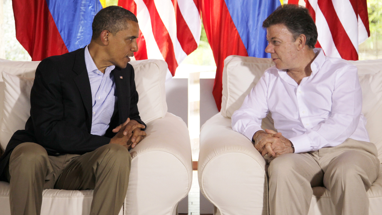 President Barack Obama, left, talks to Colombia's President Juan Manuel Santos before the start of their meeting at the Casa De Huespedes during the sixth Summit of the Americas, in Cartagena, Colombia, Sunday April 15, 2012. (AP/Carolyn Kaster)