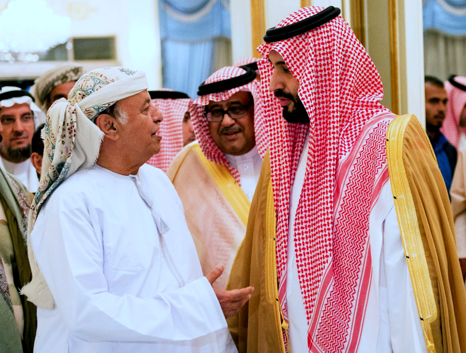 Abed Rabbo Mansour Hadi, left, talks with Saudi Defense Minister Mohammed bin Salman as he arrives in Riyadh, Saudi Arabia, Thursday, March 26, 2015. (AP Photo/SPA)
