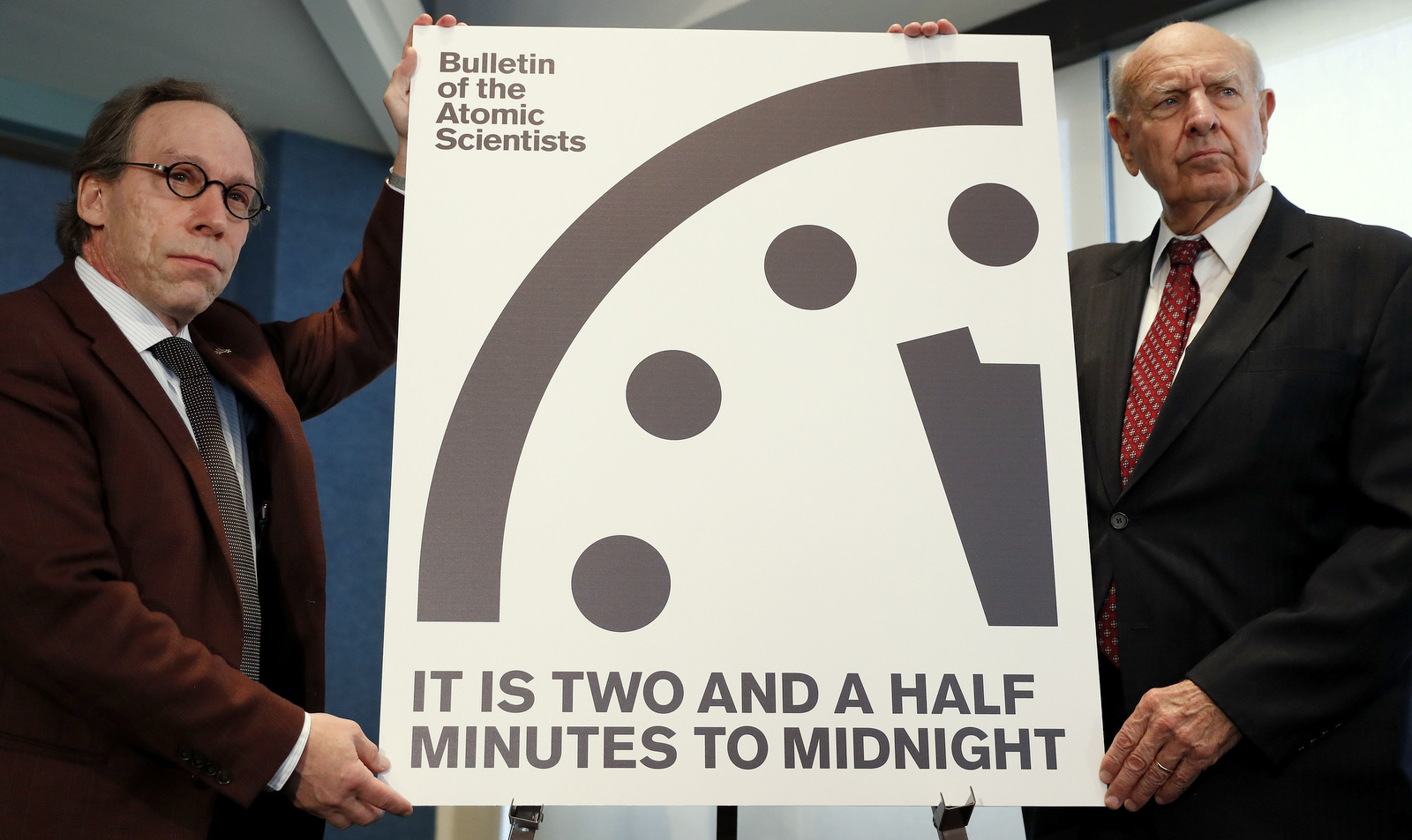 Lawrence Krauss, theoretical physicist, chair of the Bulletin of the Atomic ScientistsBoard of Sponsors, left, and Thomas Pickering, co-chair of the International Crisis Group, display the Doomsday Clock during a news conference the at the National Press Club in Washington, Thursday, Jan. 26, 2017, announcing that the Bulletin of the Atomic Scientist have moved the minute hand of the Doomsday Clock to two and a half minutes to midnight. (AP Photo/Carolyn Kaster)