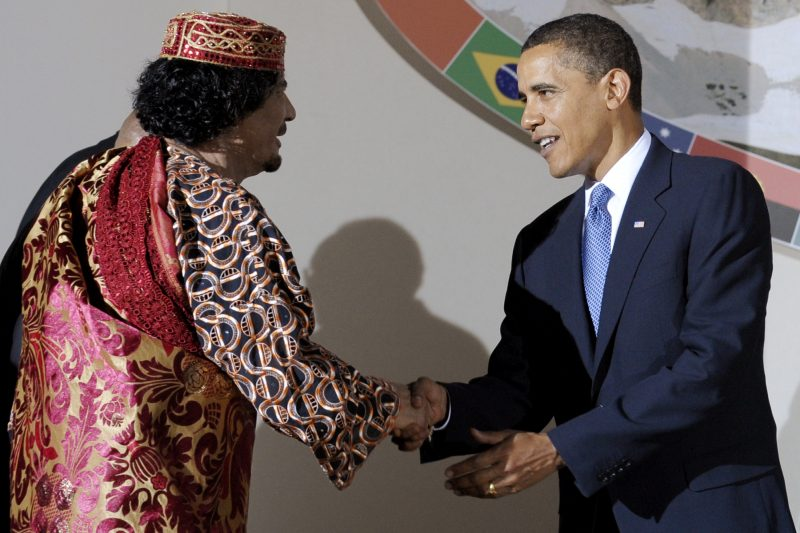 President Barack Obama greets one time ally of the United States, deposed Libyan leader Moammar Gadhafi, during the G8/G5 summit in L'Aquila, Italy, July 9, 2009. (AP/Michael Gottschalk)