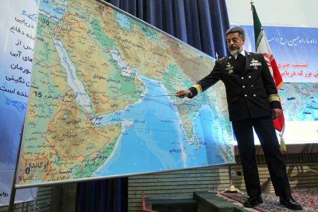 Iran's navy chief Adm. Habibollah Sayyari briefs media on a 10-day drill in international waters beyond the strategic Strait of Hormuz at the mouth of the Persian Gulf.