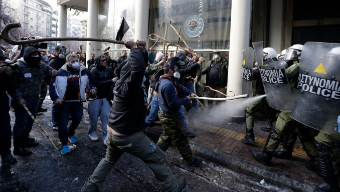 Riot police clashes with protesting farmers outside the greek Agriculture Ministry, in Athens, Wednesday, March 8, 2017. Police fired tear gas to prevent farmers from forcing their way into the ministry building, while protesters responded by throwing stones. No injuries or arrests were reported. Protesters are angry at increases in their tax and social security contributions, part of the income and spending cuts Greece's left-led government has implemented to meet bailout creditor-demanded budget targets.(AP/Thanassis Stavrakis)