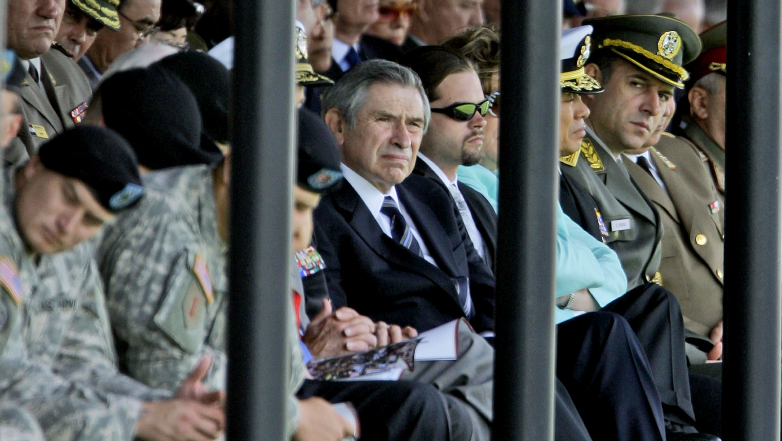 Former Deputy Defense Secretary, and former World Bank President Paul Wolfowitz, center, attends a farewell ceremony for outgoing Joint Chiefs Chairman Gen. Peter Pace. (AP/Pablo Martinez Monsivais)
