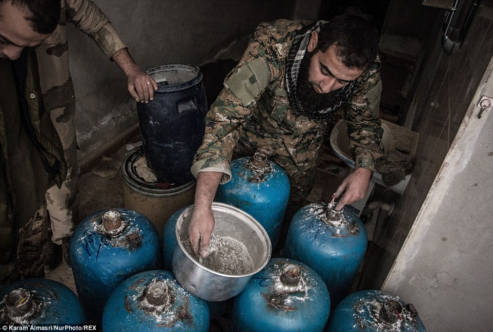 Syrian rebels prepare highly modified propane gas cylinders for use as ammunition in homemade 'hell cannons'.