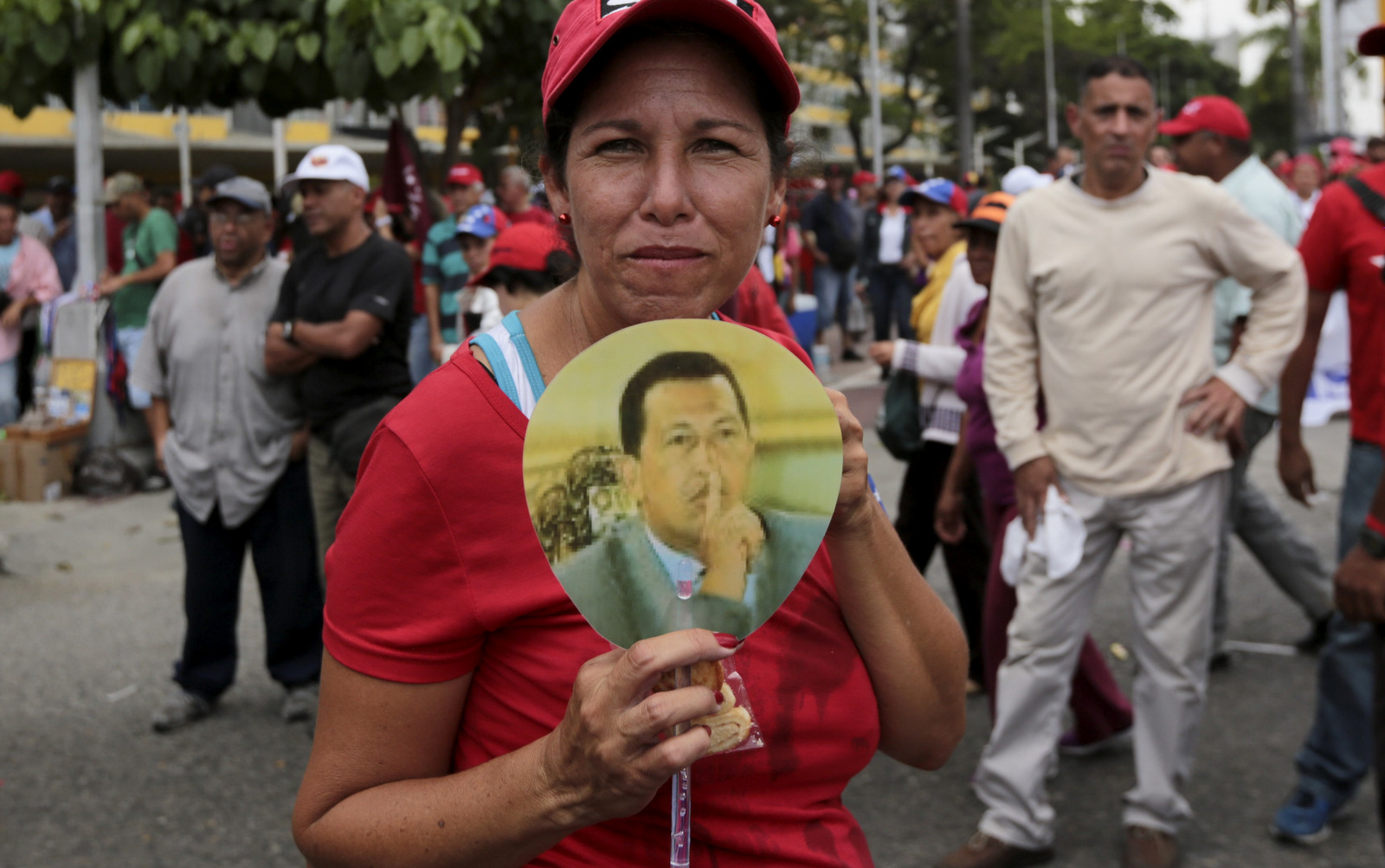 A government supporter holds an image of Venezuela's late president Hugo Chavez, during a march in Caracas, Venezuela, Wednesday, April 19, 2017. (AP/Fernando Llano)