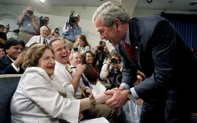 President Bush, right, greets veteran White House correspondent Helen Thomas. Thomas, was a correspondent for more than 50 years before she fired due to comments her critics described as anti-Semitic. (AP/Charles Dharapak)