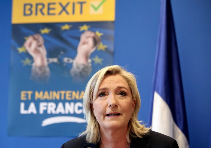 French far-right leader Marine Le Pen speaks during a press conference at the National Front party headquarters in Nanterre, outside Paris, Friday, June 24, 2016. (AP/Kamil Zihnioglu)