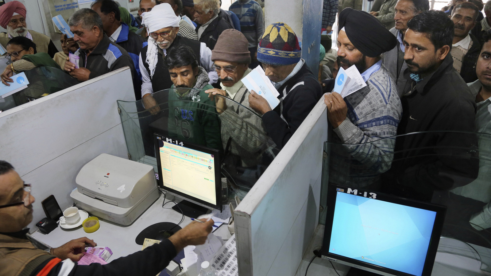 Indians stand in line to deposit discontinued notes in a bank in Jammu and Kashmir, India,, Dec. 30, 2016. India yanked most of its currency bills from circulation without warning on Nov. 8, delivering a jolt to the country's high-performing economy and leaving countless citizens scrambling for cash. (AP/Channi Anand)