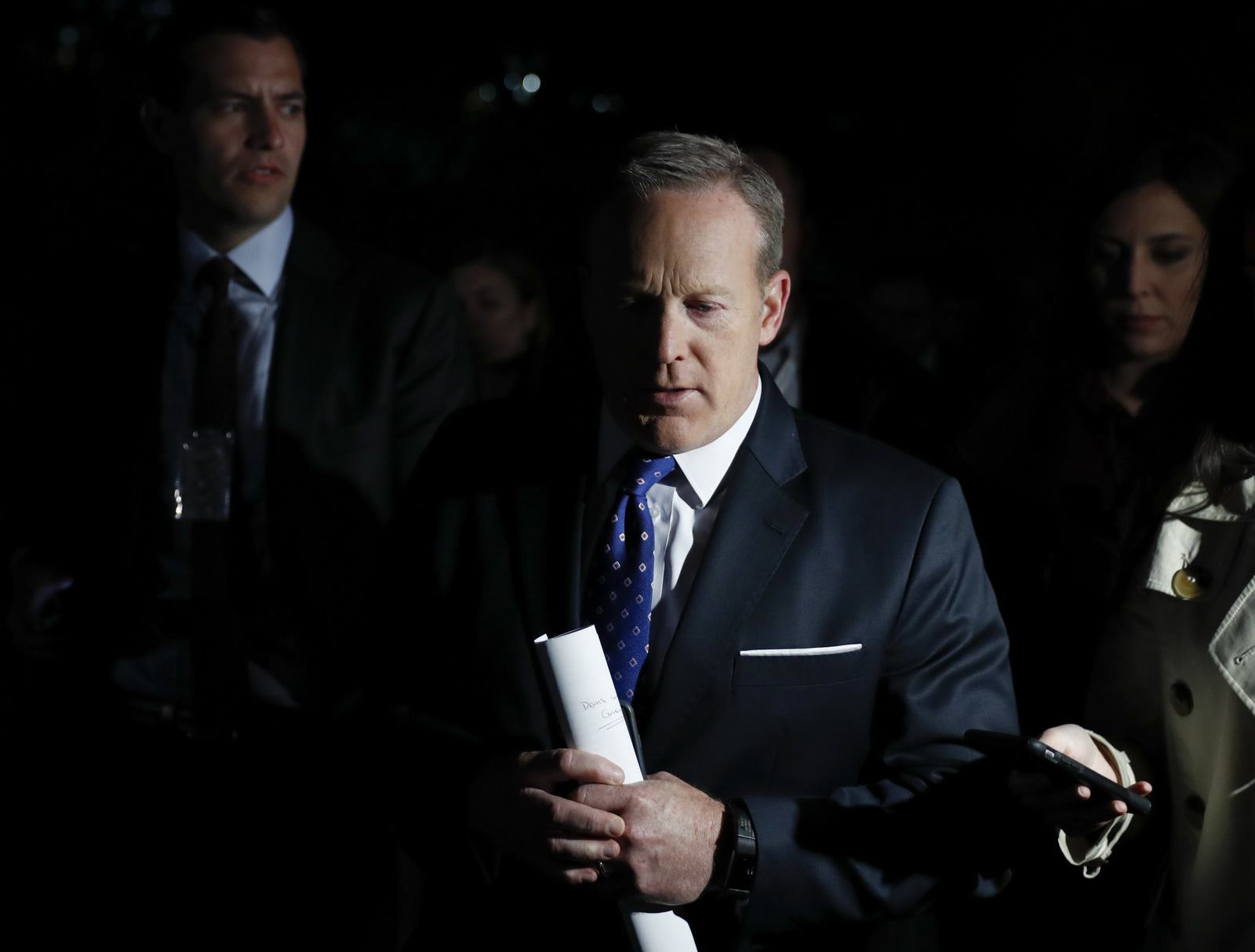 White House press secretary Sean Spicer talks to media as he walks to the West Wing of the White House, in Washington, May 9, 2017. (AP/Carolyn Kaster)
