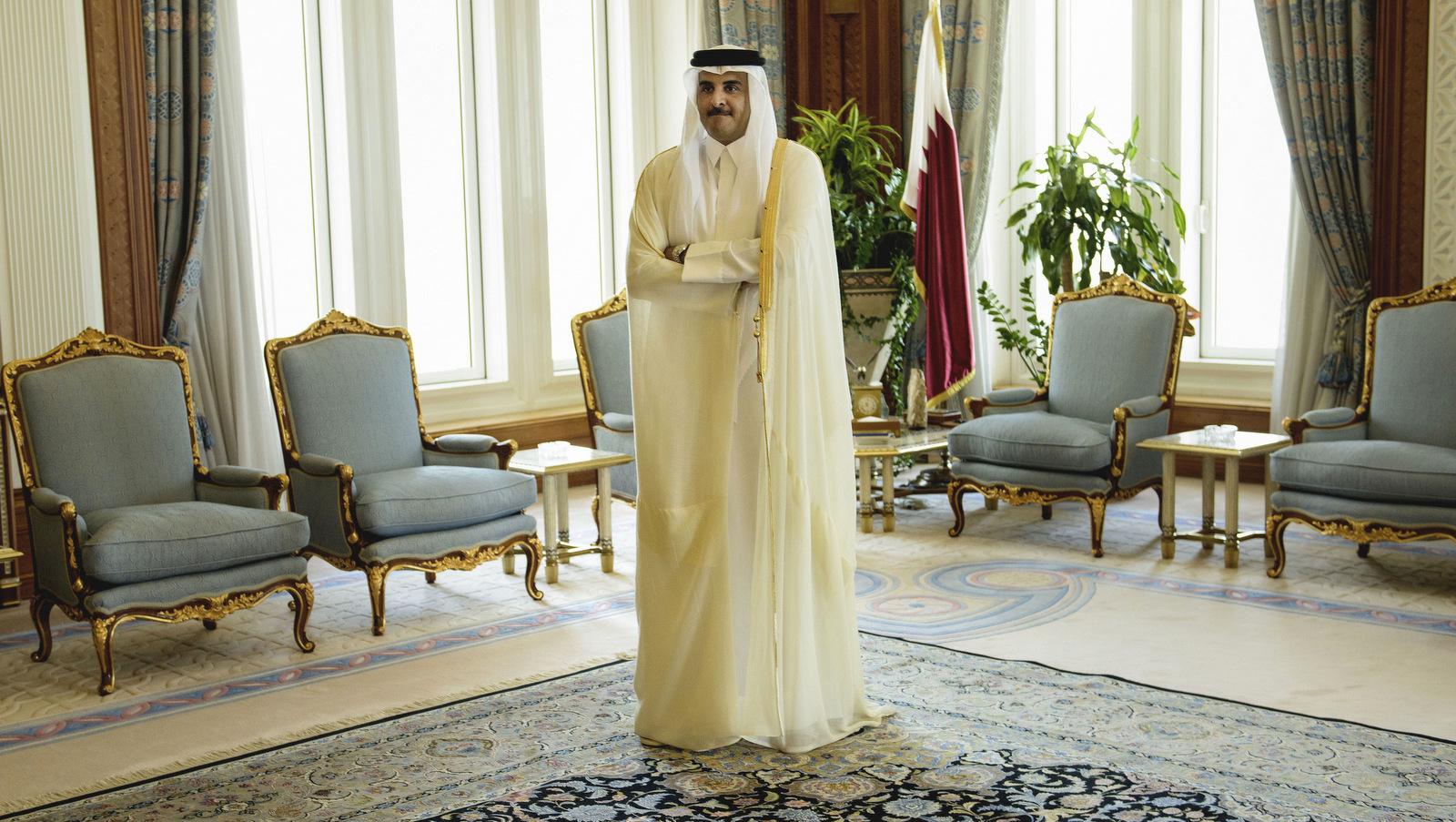 Qatar Emir Sheik Tamim bin Hamad Al-Thani waits for the arrival of U.S. Secretary of State John Kerry ahead of their meeting, at Diwan Palace in Doha, Qatar. (Brendan Smialowski/AP)