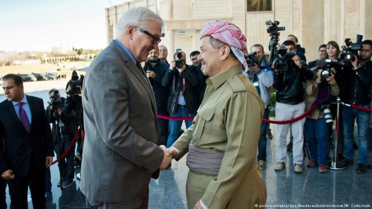 German Foreign Minister Frank-Walter Steinmeier pledges German military support to the Kurds in northern Iraq during a meeting in Erbil with Masoud Barzani, president of the Iraqi Kurdistan region.