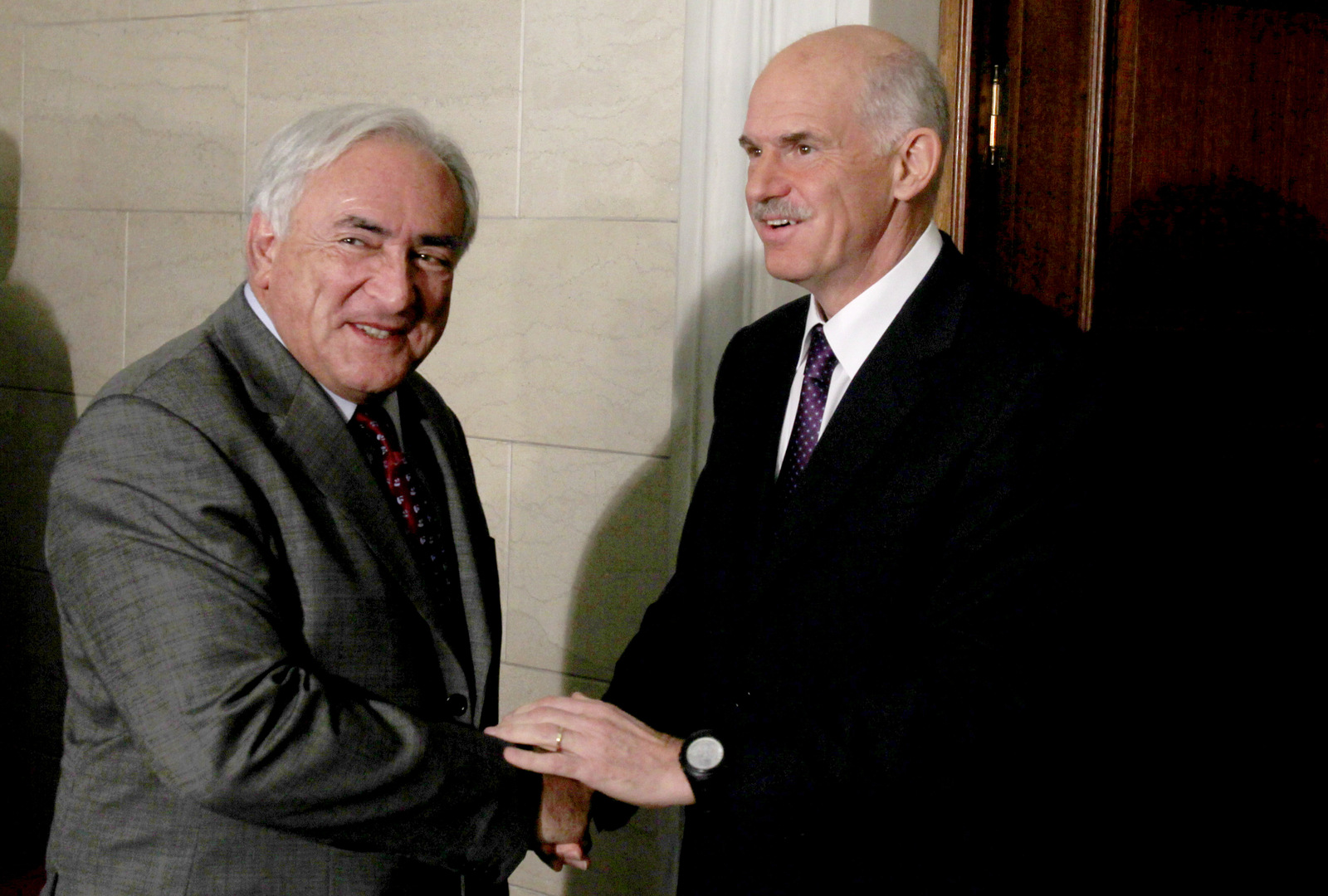Greek Prime Minister George Papandreou, right, welcomes the head of the International Monetary Fund Dominique Strauss-Kahn at his office in Athens on Dec. 7, 2010. Strauss-Kahn was in Greece to negotiate terms of the repayment of the three-year euro110 billion ($150 billion) bailout loan intended to saved the debt-ridden country from default. (AP/Thanassis Stavrakis)