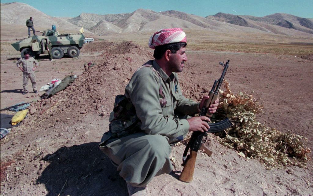 A Kurdistan separatist fighter waits at his position near Degala, Iraq. Oct. 16, 1996 during fighting between rival Kurdish factions. (AP/Burhan Ozbilici)