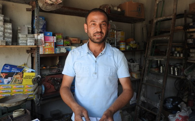 The owner of small hardware shop in eastern district Bab al-Hadid, The shop owner, who wished to remain anonymous, said he fled life under the rule of Syria's rebels groups, returning only the government restored the rule of law in the area. (Eva Bartlett/MintPress News)