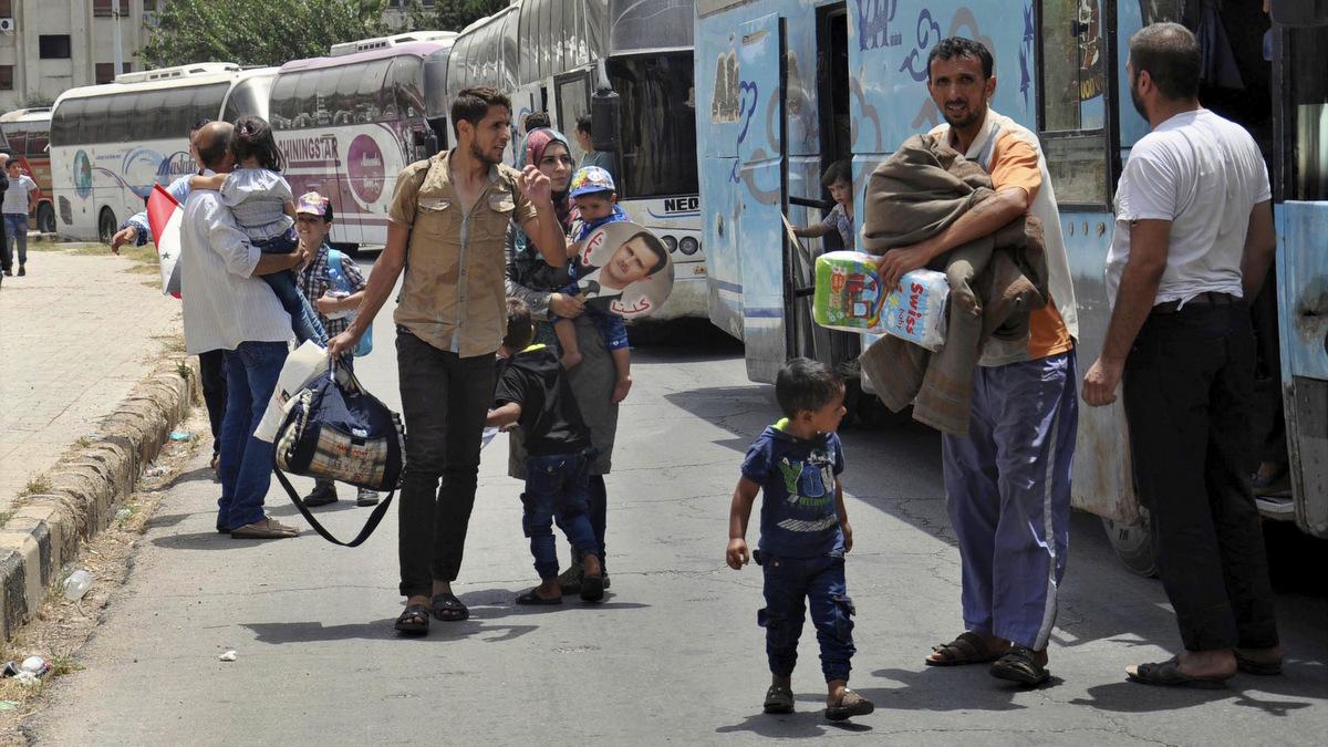 Syrians arriving from Jarablus, in Aleppo province, to their old neighborhood of al-Waer, in Homs, Syria, July 11, 2017. (SANA via AP)