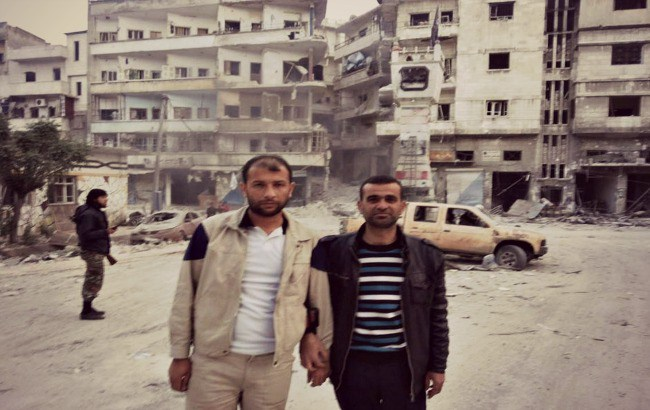 Raed Saleh photographed with Mustafa Al Haj Yussef, a White Helmets leader, in Khan Sheikhoun, Idlib. (Photo: Facebook)
