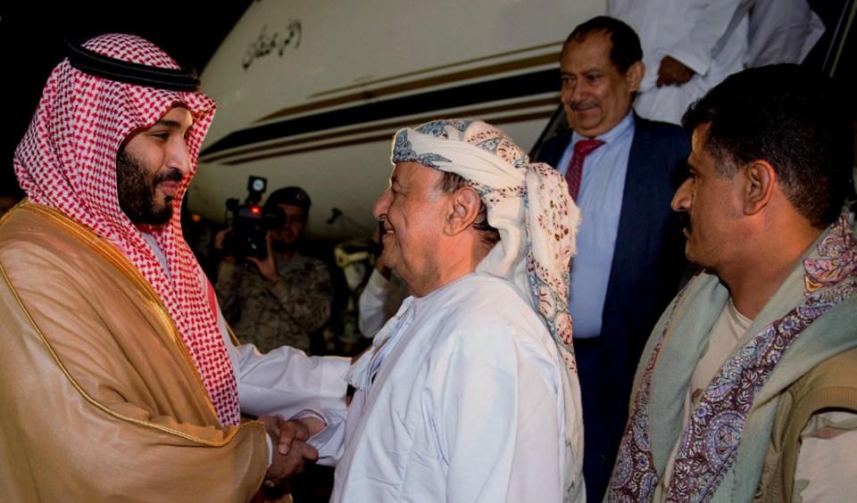 Saudi Prince Mohammed bin Salman, left, welcomes Yemen's Abed Rabbo Mansour Hadi as Hadi arrives at an airbase in Riyadh, Saudi Arabia, March 26, 2015. (AP Photo/SPA)