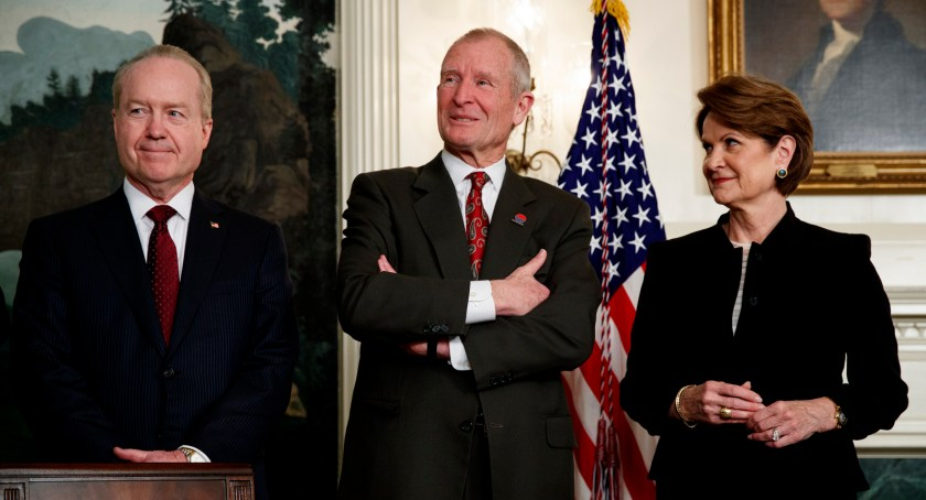 Raytheon CEO Tom Kennedy, left, former Director of National Intelligence Dennis Blair, center, and Lockheed Martin CEO Marillyn Hewson wait for the arrival of President Donald Trump in the Diplomatic Reception Room of the White House, March 22, 2018. (AP/Evan Vucci)