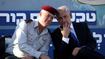 Israeli Prime Minister Benjamin Netanyahu, right, speaks with Israeli Chief of Staff Lt. Gen. Benny Gantz, during a graduation ceremony of navy officers in the northern port city of Haifa, Israel, Sept. 11, 2013. Dan Balilty | AP
