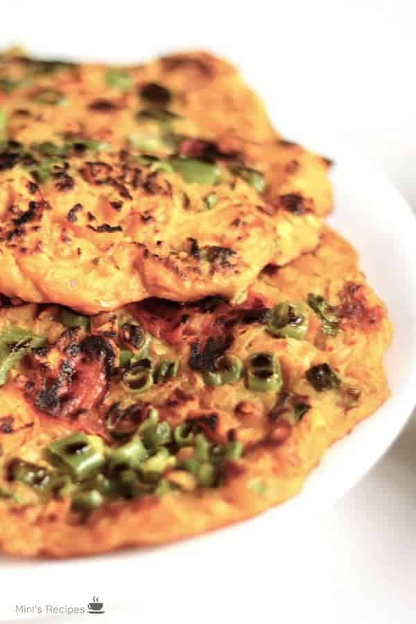 Potato Laccha Pancake on a white plate and garnished with some coriander leaves
