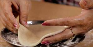 Roll chapati on a dusted plate