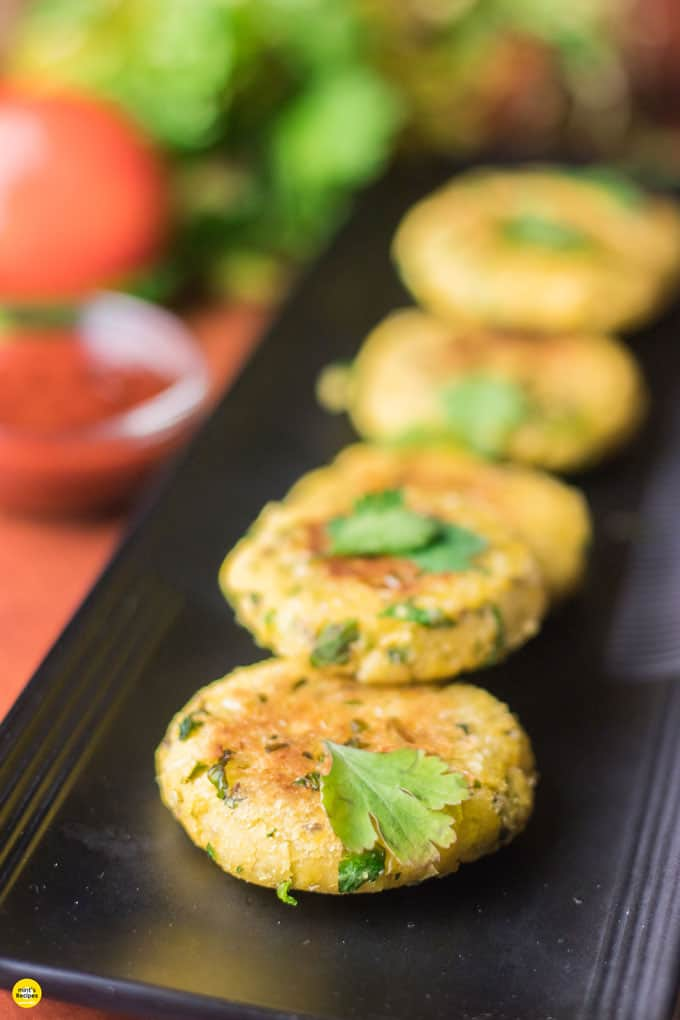 Sweet corn fritters on a black plate