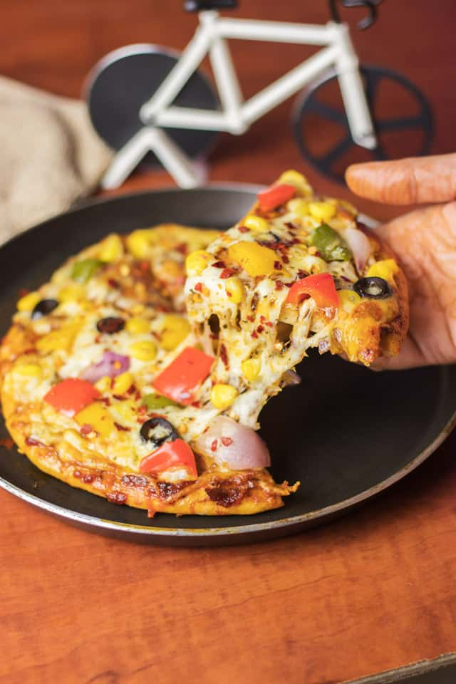 Veg Atta Pizza on a black pan