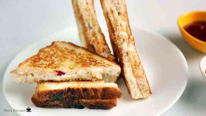 Veg Curd Sandwich on a wooden surface with some green chutney and tomato sauce | www.mintsrecipes.com |