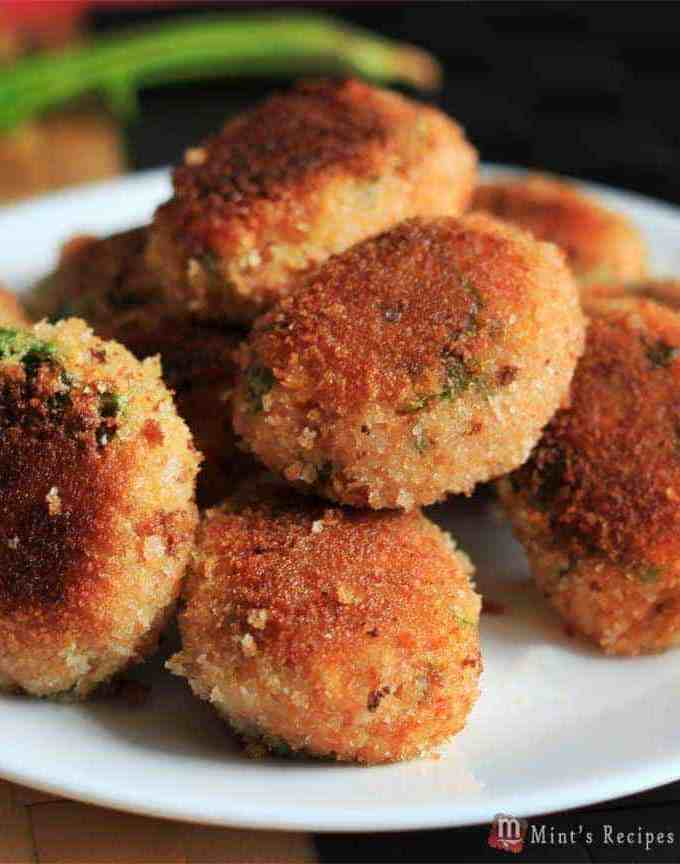 Veg Poha Cutlet on a white cutlet with some poha cutlets and a dark background  