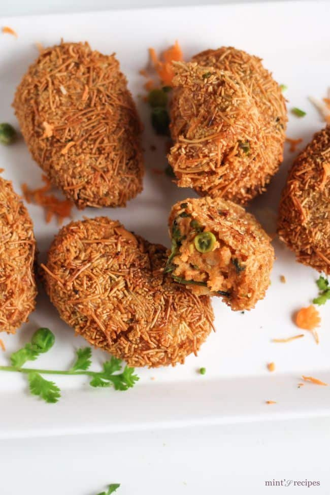 Potato vermicelli cutlet recipe mints recipes potato vermicelli cutlet on a white rectangular plate with some grated carrots and some coriander leaves forumfinder Image collections