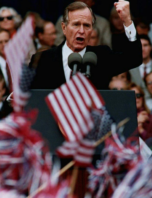 George Bush is seen here talking to a crowd of supporters in suburban St. Louis in 1992 near the end of what would be his only term in office