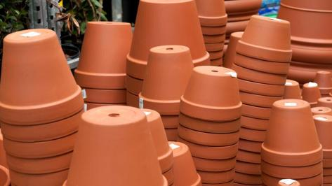 Different sized pots stacked up on top of each other.