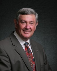 Dennis A. Schoville Chairman of the Board