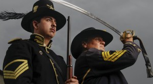 Civil War re-enactors (from left) Quartermaster Sgt. AJ Gonzalez, Sgt. Major Jean Roberts (as Sgt. Major Hal Roberts)(a female), pose for a photo in their Civil War uniforms on Tuesday in San Diego, California. They are participating in the reburial of Civil War veteran Charles Schroeter. — Eduardo Contreras / San Diego Union-Tribune/TWEETS @