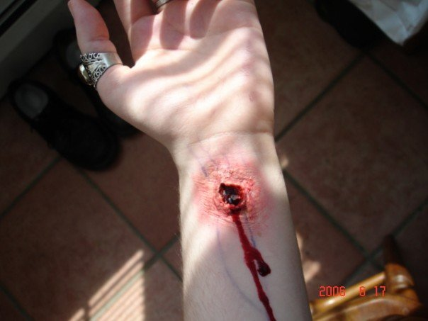 trauma, wound, sfx make up, special effects makeup, wax, liquid latex, blood stigmata, puncture wound, wrist